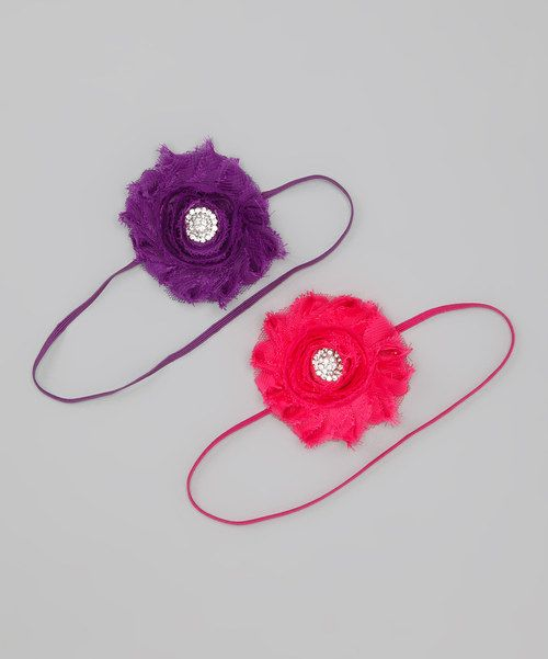 Sparkling rhinestone nestles in sweet swirls of a blossom that tops this thin, stretchy band for a perfectly pretty piece that makes an elegant topper for any little lady's ensemble.Includes two headbandsFlower: 3'' diameterCotton / polyester