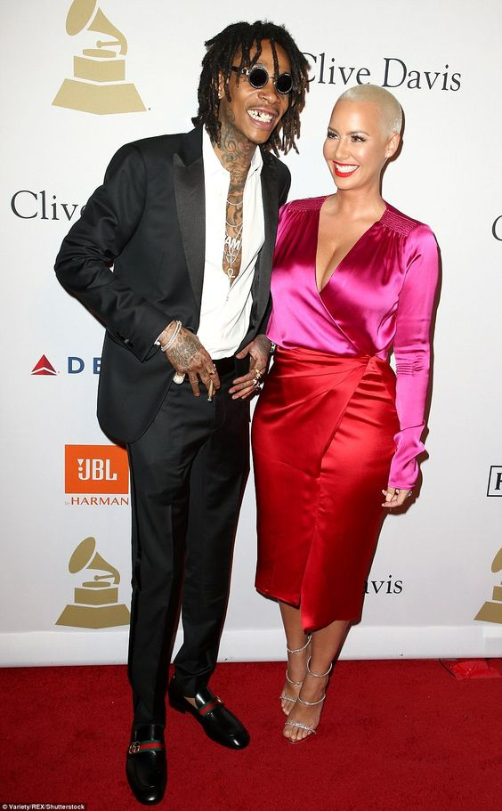 Unexpected duo: Rapper Wiz Khalifa, 29, donned only a simple suit with no tie for the event, but surprised regardless by showing up with ex Amber Rose, 33, on his arm: