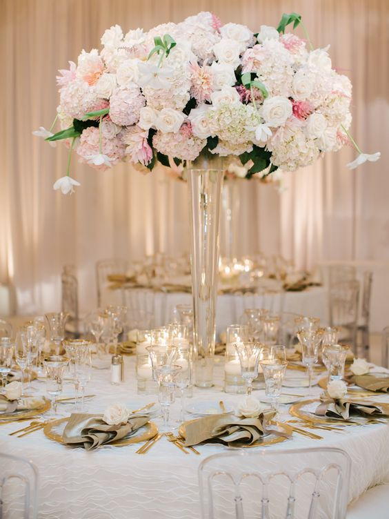 Modern spring bridal shower with a pink gold black for Floral arrangements for wedding reception centerpieces