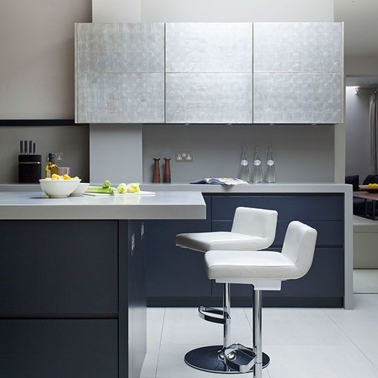 Modern kitchen with blue and silver-leaf cabinetry  Fixtures rarely look as spectacular as this handleless silver-leaf cabinetry. Beautifull...