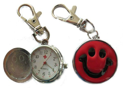 Red watch has smiley face on the front & opens up to reveal a clock inside. Keychain attached at the end of the watch. Visit our website to order: http://happy-hoods.com