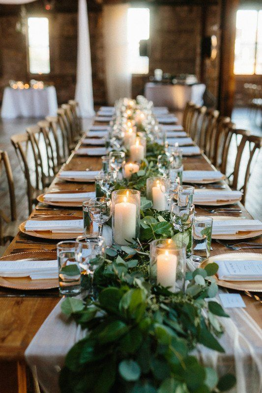 Greenery garland wedding centerpiece idea with candles