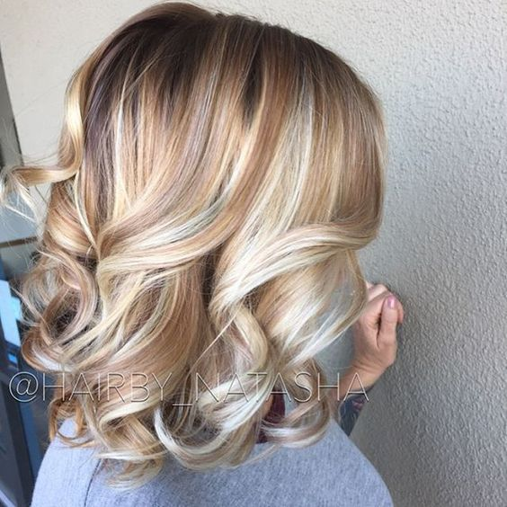 DIMENSION! Added a honey blonde and shadowed root using all @schwarzkopfusa color for my mega babe of a client. Fall blonde is a thing❤️