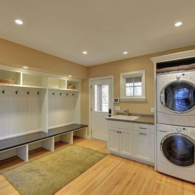 absolutely love this open concept for combo laundry/mudroom.  Plenty of space, mudroom area right off entry...Lighting too - window in door, above sink, even recessed lighting