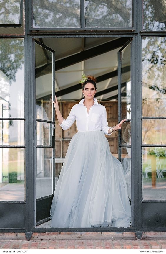 Dramatic bridal look with white collared shirt and light blue tulle skirt | Skirt by Janita Toerien | Photograph by Tasha Seccombe |: