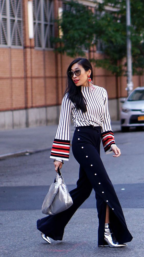 """The best attention to details from nyfw: chic high waisted flared popper pants, striped top sweater, """"pendance"""" combination with silver bag and ankle boots. A really accurate and trendy outfit for 2018 #anklebootsoutfit"""