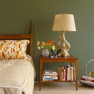 Love this olive green wall colour set off by the teak for Retro bedroom ideas