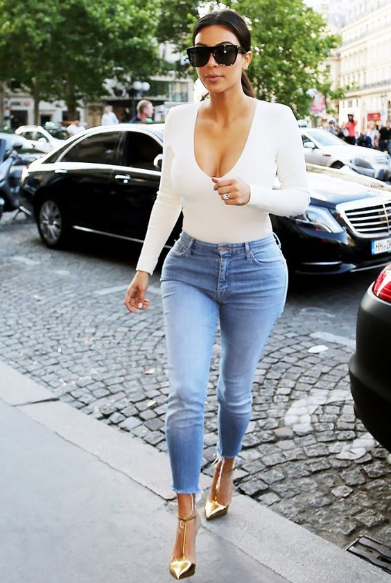 Kim Kardashian rocking a long-sleeved body suit. #celebritystyle