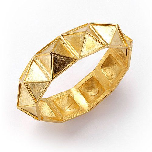 Kenneth Jay Lane Pyramid Bangle Bracelet Goldplated. One of the more unique and impressive pieces of jewelry you can get without literally raiding an ancient treasure chamber, this bold and angled brushed gold bangle by Kenneth Jay Lane comes both fashion-ready and curse-free.