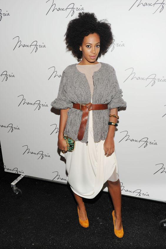 Another thing Solange does extremely well: layer. For the Max Azria Spring 2011 runway show during New York Fashion Week, she chose a grandpa sweater and flowing skirt, which she held together with a thick brown leather belt.