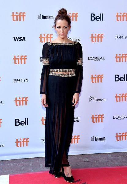 Riley Keough Sheer Dress - Riley Keough looked divine in a sheer, pleated gown by Chanel, featuring gold beading and cutouts along the midsection and sleeves, during the TIFF premiere of 'American Honey.'