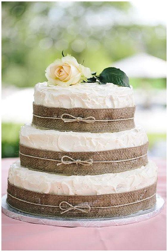 40+ Hessian Wedding Ideas - wrap hessian ribbon around each tier of the wedding cake and tie with twine for a rustic wedding #weddingideas #hessianwedding #rusticweddingideas