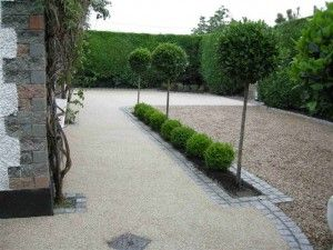 Resin bond paving - porous. and gives a soft, elegant finish. Looks decent if edged nicely; cool orb hedges