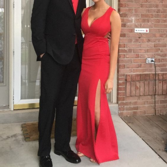 Gorgeous Red Prom dress Only worn once!! Red full body dress with side cutouts and a fully covered back with a zipper. One slit on the dress on the left leg. Super light weight and really comfortable fabric. Dresses Prom
