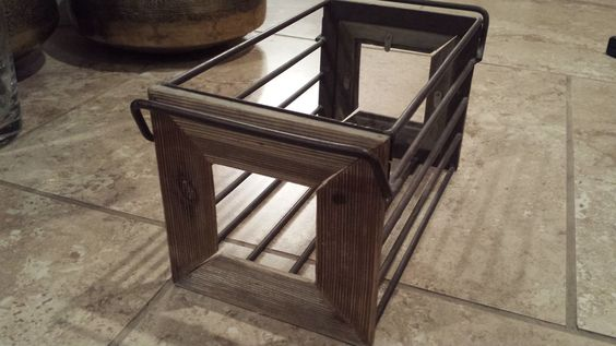 Vintage holder with picture frame on both side.  Cool idea for scrapebook storage with photograph in each end.