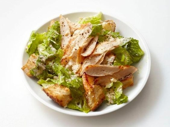 While some restaurant Chicken Caesar Salads can be chock-full of ingredients and a heavy dressing, this recipe is simple and easy.  #RecipeOfTheDay