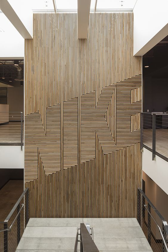 NIKE WOOD FEATURE WALL FWD// has designed the feature walls for the NIKE expansion buildings. Here is an image of the first installed wall at the Willamette building using salvaged maple gym flooring, tongue side exposed…