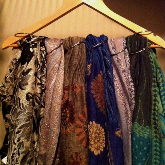 Great way to keep scarves tidy in your closet. Just use shower hooks and hanger!