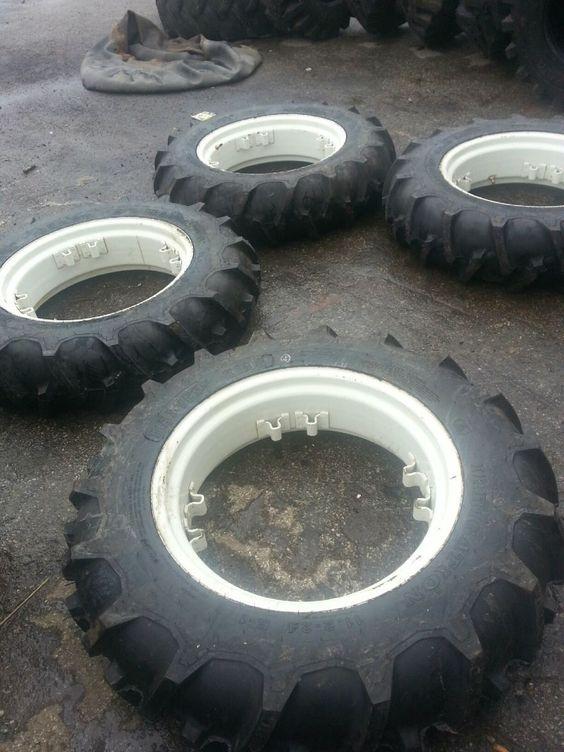 FOUR 11.2x24 Kubota, Deere, IH R1 Tractor Tires on Used 4 Double Loop Wheels