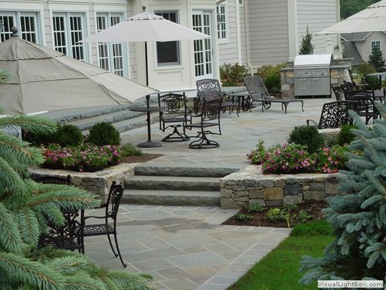 Raised concrete patio design ideas raised patio with for Fireplace on raised deck