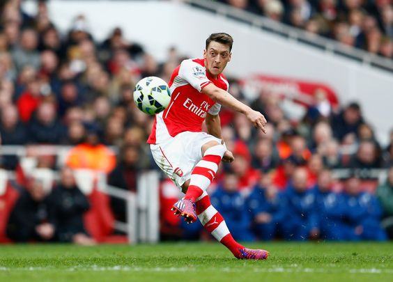 Mesut Oezil of Arsenal scores his team's second goal from a free-kick during the Barclays Premier League match between Arsenal and Liverpool at Emirates Stadium on April 4, 2015 in London, England.