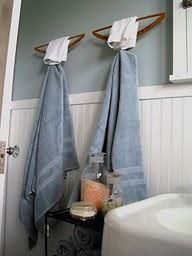 Take old wood clothes hangers, turn them upside down and you have ingenious towel holders in your bathroom.  Bend the  hanger part, up for a hook.