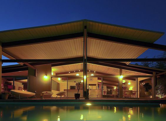 William Krisel - exterior roof line + floor to ceiling glazing + pool + interior mid-century chairs + pendants + clock & continuation of ceiling & beams inside to out