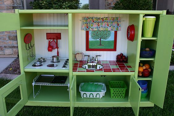 Play kitchen made out of an old entertainment center.