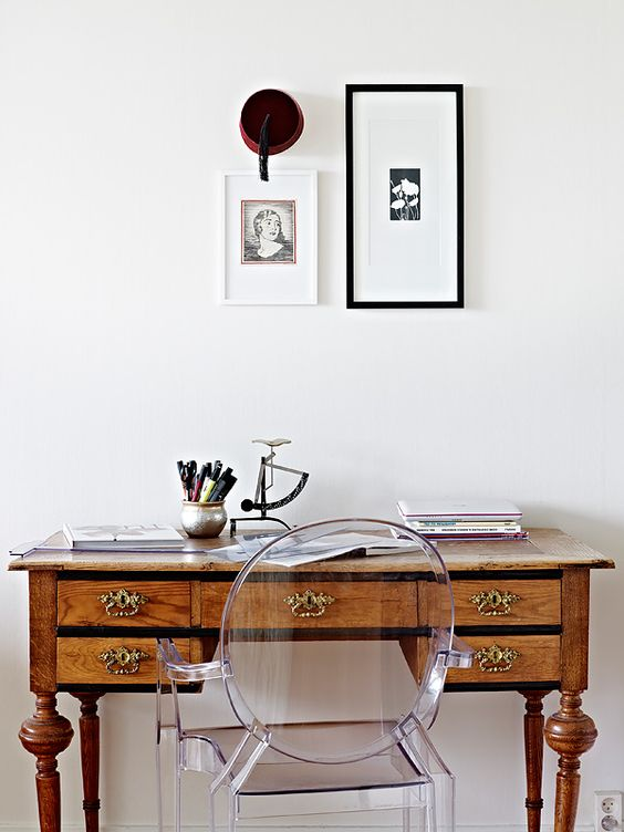 I like this little work space.  A vintage or antique wood writing desk with turned legs and a modern clear Louis Ghost Chair by Philippe Starck.  Nice. http://cococozy.com: