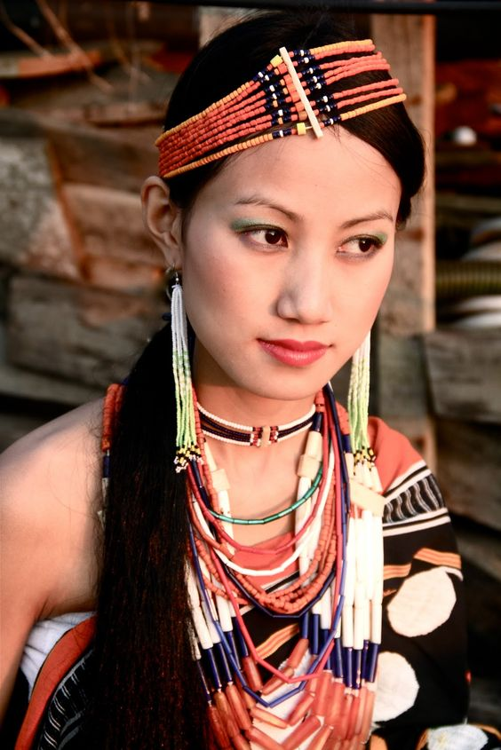 Yimchunger is one of the minor Naga tribes of Nagaland. According to the Yimchunger tradition, the tribe emerged at a village called Moru, and then came to the Jure village. The Yimchungers and the Khiamungans are believed to have migrated to the present-day Nagaland from Upper Burma as one group, in one wave. They separated into two groups at the Moru village. The traditional dress of the Yimchungers includes colorful cane-made headgear decorated with hair and bird feathers.