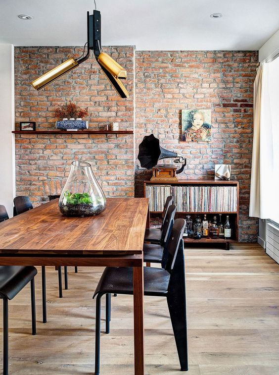 Industrail-elements-shape-the-renovated-dining-space-with-brick-walls