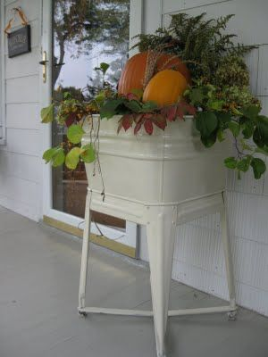 Vintage White Laundry Tub filled with foliage and pumpkins...great front porch fall display.