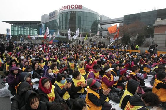 1,000 female workers stage a rally to mark International Women's Day in Seoul, South Korea