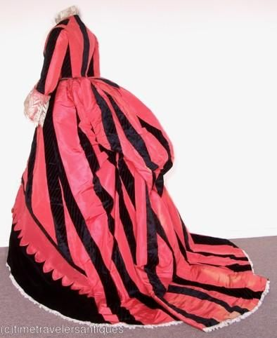 1869 Promenade Gown.  Unusually bold for this era.