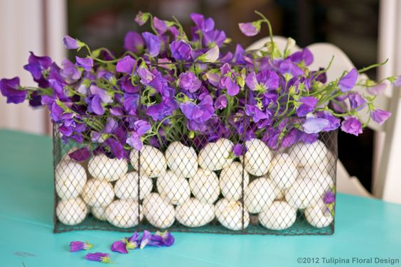 Sweet Peas and eggs inside French wire basket for Easter   http://fb.com/tulipinadesign