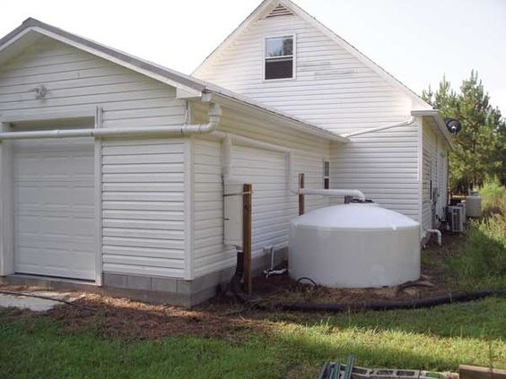 You can design a rainwater collection system such as this one by harvesting rainwater to provide water for your home and garden.: