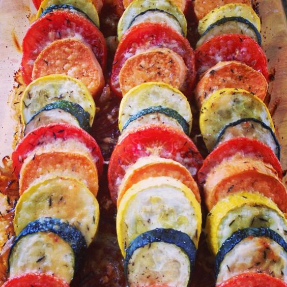 Vegetable Tian-so easy/everyone loved it!    1 onion  2 garlic cloves  2 round potatoes, unpeeled ( I used sweet pot)  1 zucchini  1 yellow squash (I used summer squash)  2-3 tomatoes  salt/pepper   Thyme  Parm Cheese  Olive Oil    Preheat oven to 375.  Brush a baking dish w/ olive oil.   Saute onions w/ a tablespoon of olive oil (8 mins). Add garlic.  Layer mixture on pan and place sliced veggies on top. Drizzle w/ olive oil. Cover w/ foil for 30 mins, uncover and sprinkle chz-bake for…