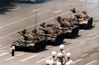 """This day in News History: """"Tank Man"""" stands in front of a column of tanks on June 5, 1989, in Beijing during the protests in #TiananmenSquare. Photo by Jeff Widener of the Associated Press."""