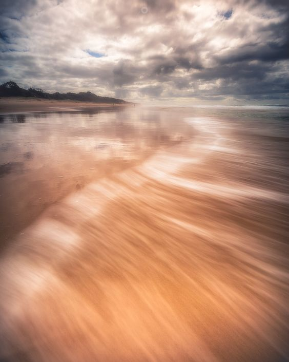 Sweeping In - A long exposure, landscape image of waves washing ashore at Peregian Beach in Queensland, Australia, at sunset.