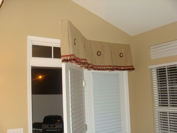 Soft cornice swing door treatment ties together adjoining side window