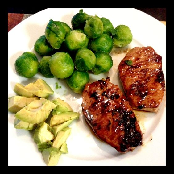 Quick & Easy Dinner - 6oz pork chop sautéed in coconut oil and coconut aminos with steamed brussel sprouts and avocado #yum #paleo