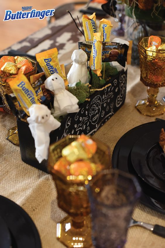 No Halloween party is complete without the candy! Add this DIY Butterfinger Booquet to your party decor so there's always a treat for your tricky guests to snack on. To make these decorative ghosts, place BUTTERFINGER® Peanut Butter Cup Minis on lollipop sticks and wrap with a tissue. This easy centerpiece idea will double as party favors for all of your guests to take home at the end of the night.