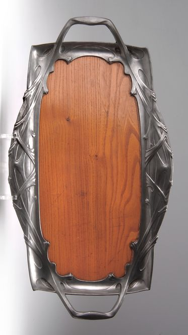 German Art Nouveau serving tray, pewter and wood, designed by Friedrich Adler, manufactured by Georg Friedrich Schmitt, under the trade name Orion, 50 x 27.5 cm.     SOLD $310 May 2004