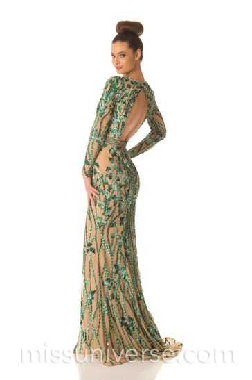 This gown with nude lining with emerald green sequin applique is striking.