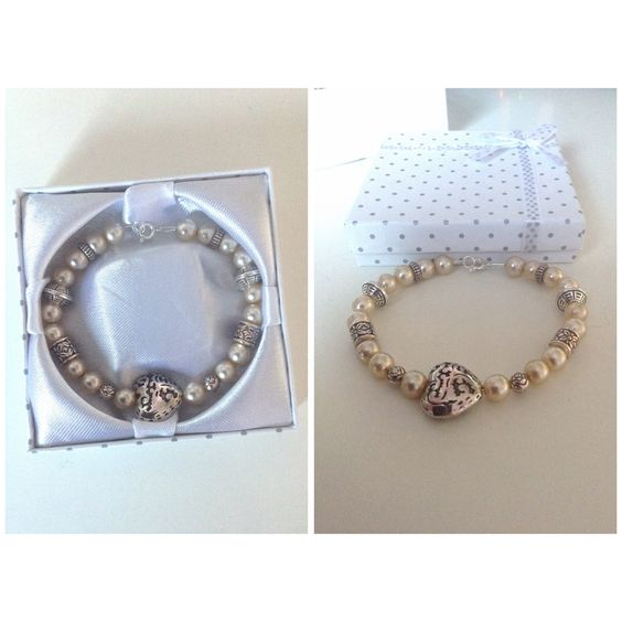 Handmade bracelet (with genuine pearls). Materials from John Lewis, apart from the pearls which were taken from a very old necklace. Displayed with a white and silver polkadot box from eBay. This is one of my favourites!