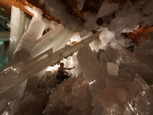 Selenite also known as Gypsum Crystal. Can you see the little man in the Pic? Naica mine in the state of Chihuahua in Mexico. It is so hot in that deep cave 118 degrees Fahrenheit, 48 degrees Celsius.