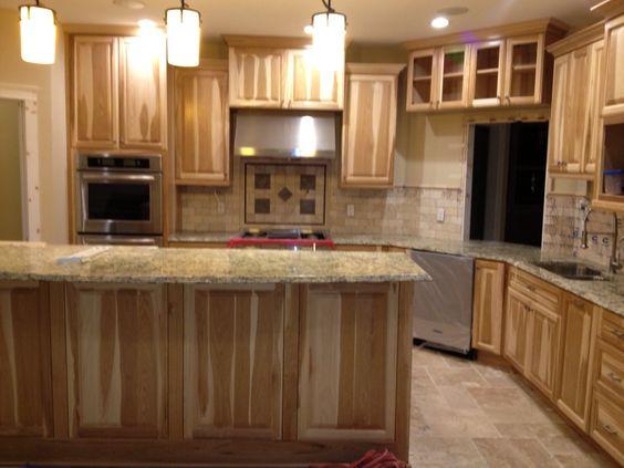 Kitchen with Hickory cabinets and travertine backsplash ...