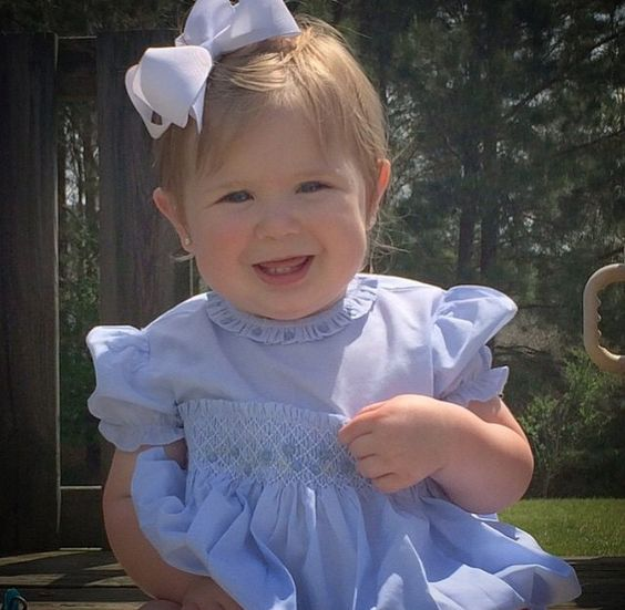 Sunny Sundays are the best! Mary Bradlie in her blue Feltman Brothers rose garden dress sure puts a smile on our face! http://www.feltmanbrothers.com/rose-garden-dress/