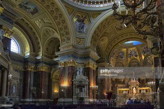 a prayer inside st.stephan's basilica,budapest,hungary.the church is the most important one in budapest,finished in 1905 after a long time due to the collapse of the dome.it is built in neo-classical style.