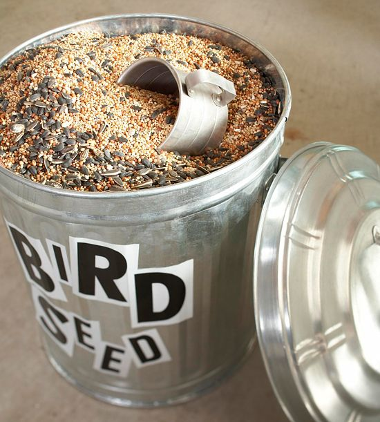 Here's a new job for a trash can: Use the sturdy containers to store messy things such as birdseed, sand, or salt. Place a cup inside for easy measuring. Print letters onto magnetic paper, cut out the letters, and use to label the cans